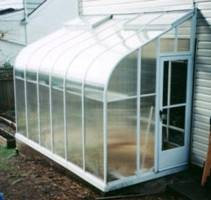 Curved Eave Lean to Greenhouse